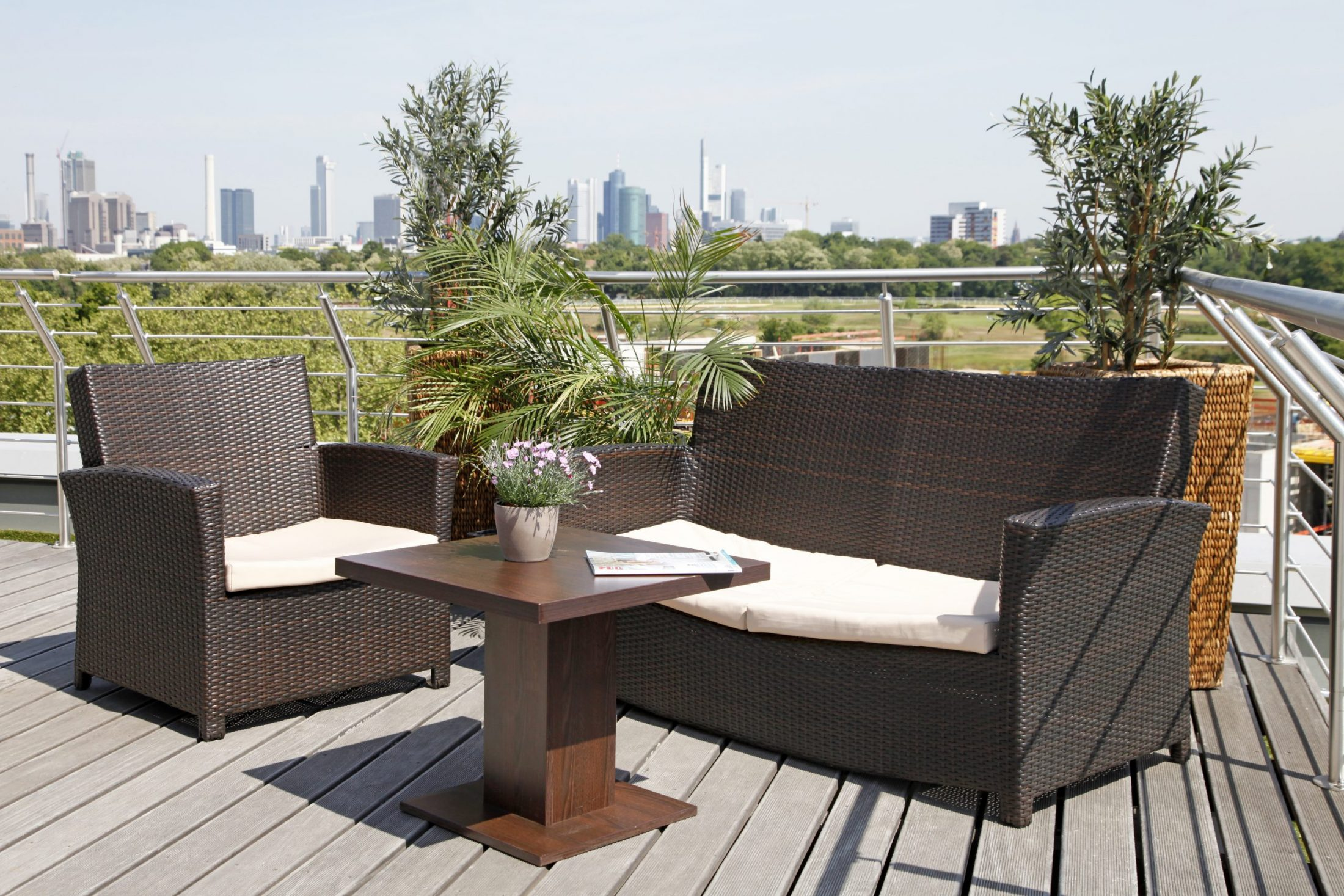 Roof Terrace Paragon Apartments Frankfurt with comfortable sofa and great view
